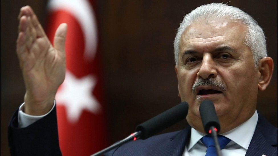 Turkish PM Binali Yildirim delivers a speech at the Grand National Assembly of Turkey in Ankara on 31 October 2017