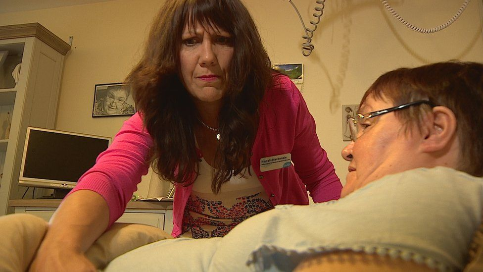 Pamela Mackenzie attends to a patient at the Dee View Court centre in Aberdeen