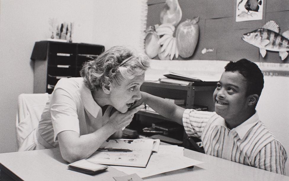 Moneta Sleet's son, Mike, with a teacher at a special needs school