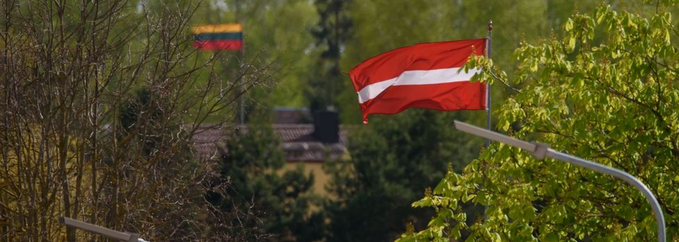 Border between Latvia and Lithuania showing the flags of the two countries
