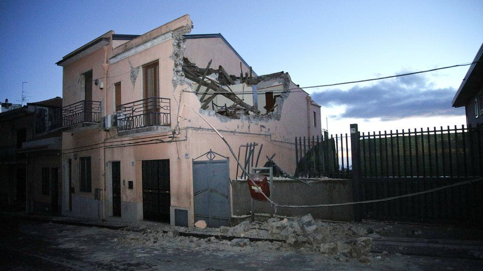 A house is seen damaged by an earthquake at the area north of Catania
