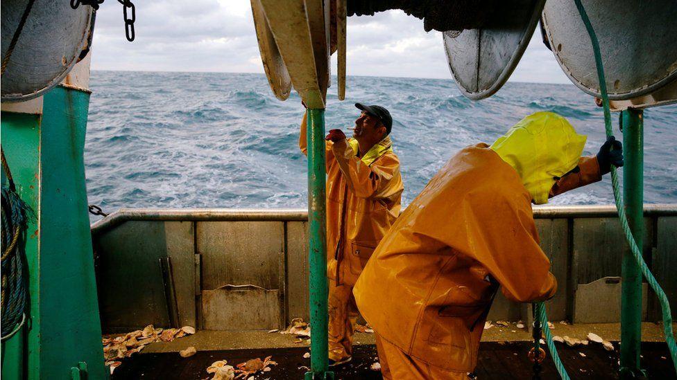 French fishermen aboard their vessel