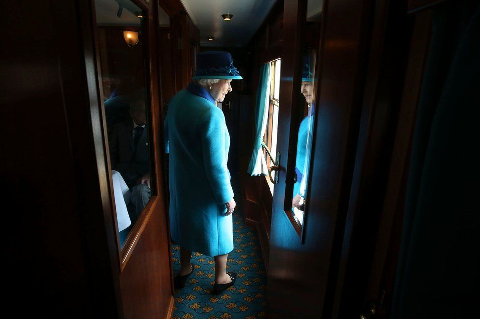 Britain's Queen Elizabeth boards her carriage as she travels on the new Scottish Borders railway line, in Scotland