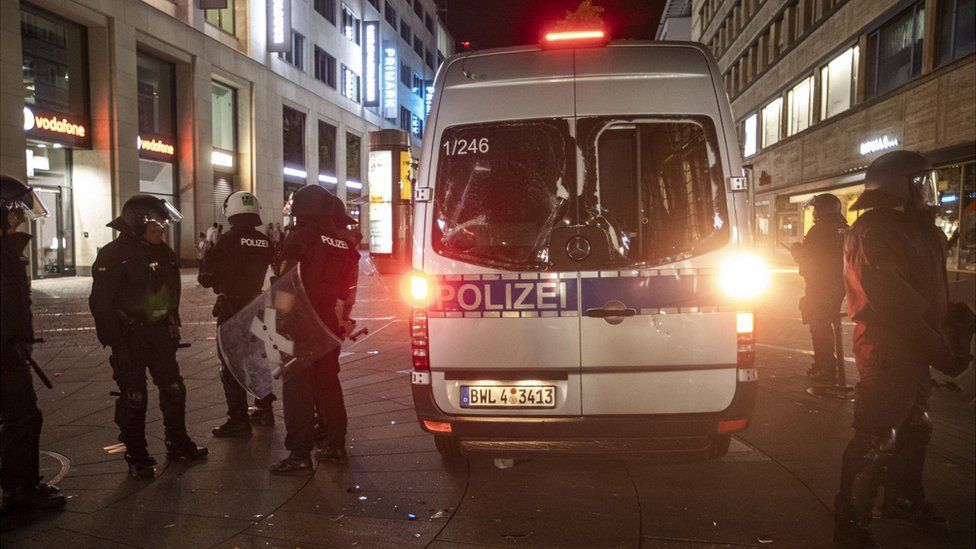 Damaged police vehicle, guarded by police in Stuttgart, 21 Jun 20
