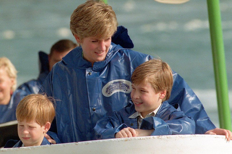 Diana, Princess of Wales, with her sons, Princes Harry (left) and William, aboard the Maid of the Mist cruiser near to Niagara Falls