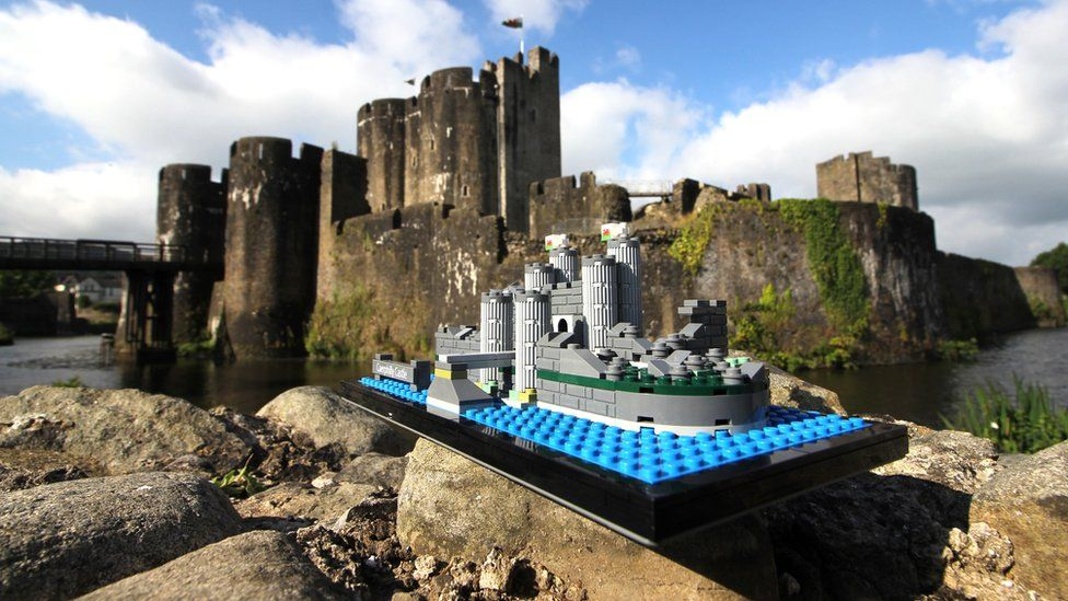 The Lego model sits alongside the real castle