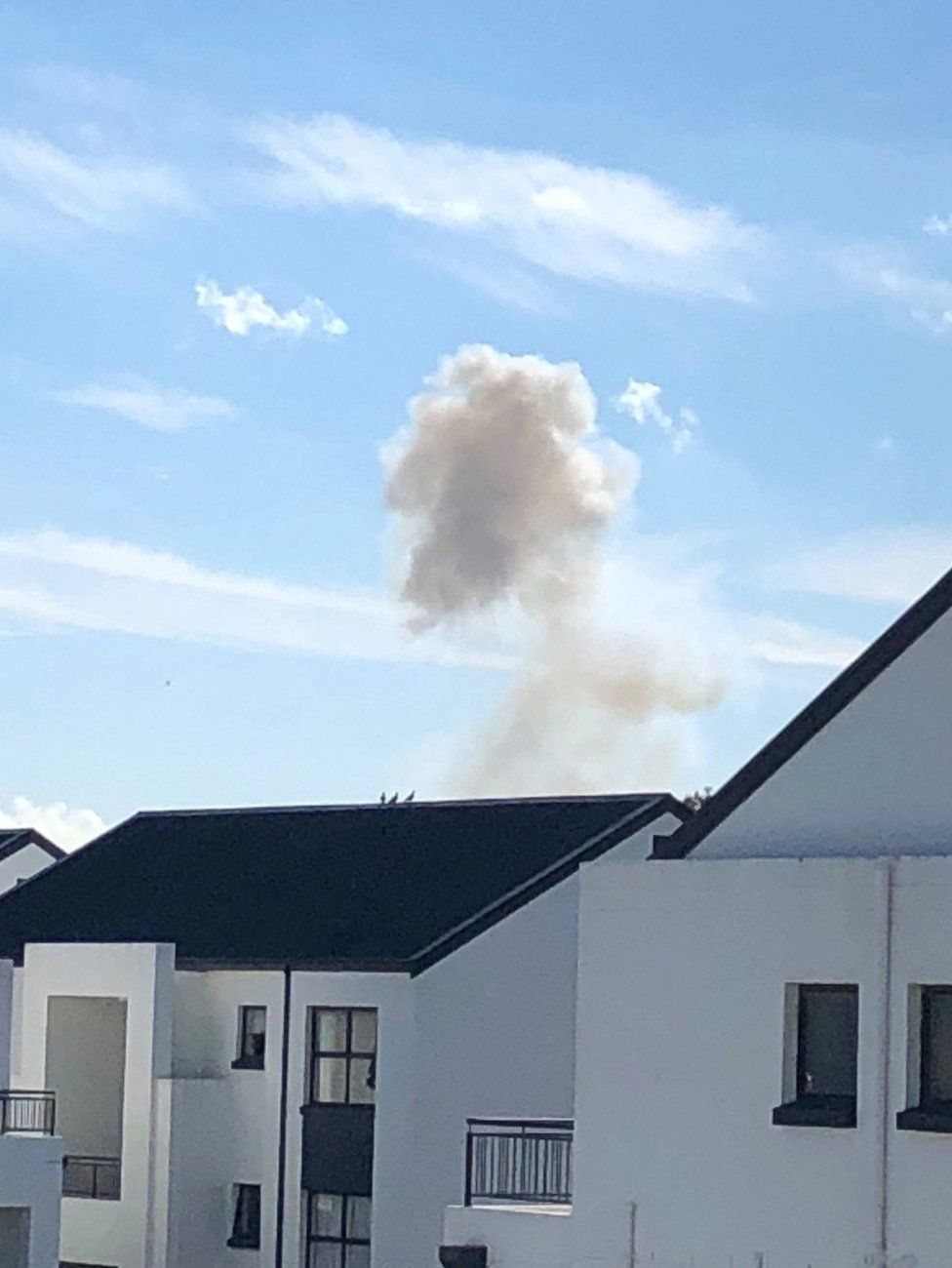 Smoke is seen during an explosion at the South African munitions depot in Somerset West, near Cape Town, South Africa, 3 September 2018
