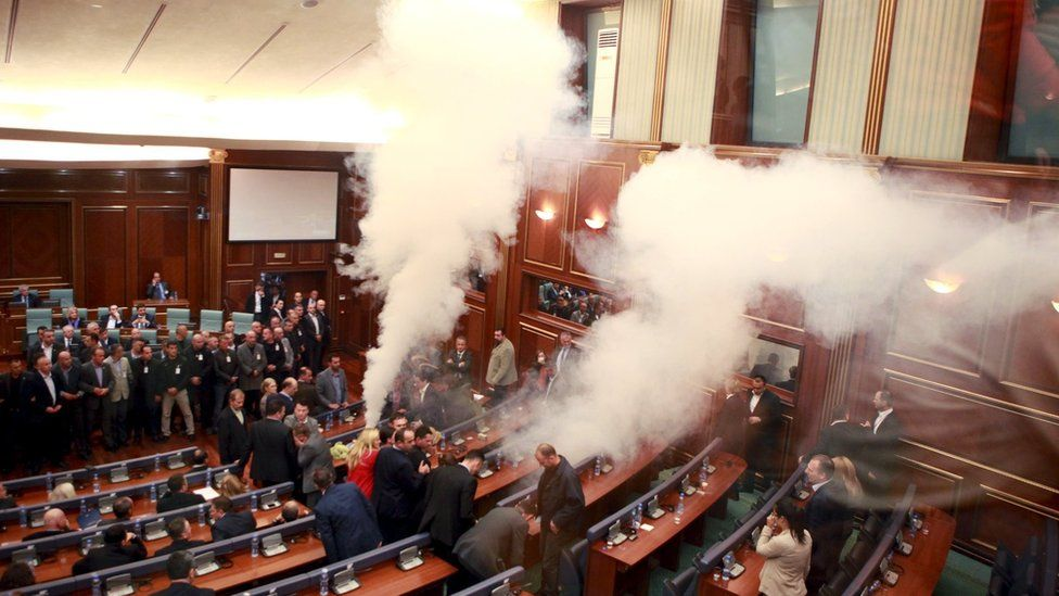 Opposition politicians release tear gas in parliament to obstruct a scheduled session in Pristina