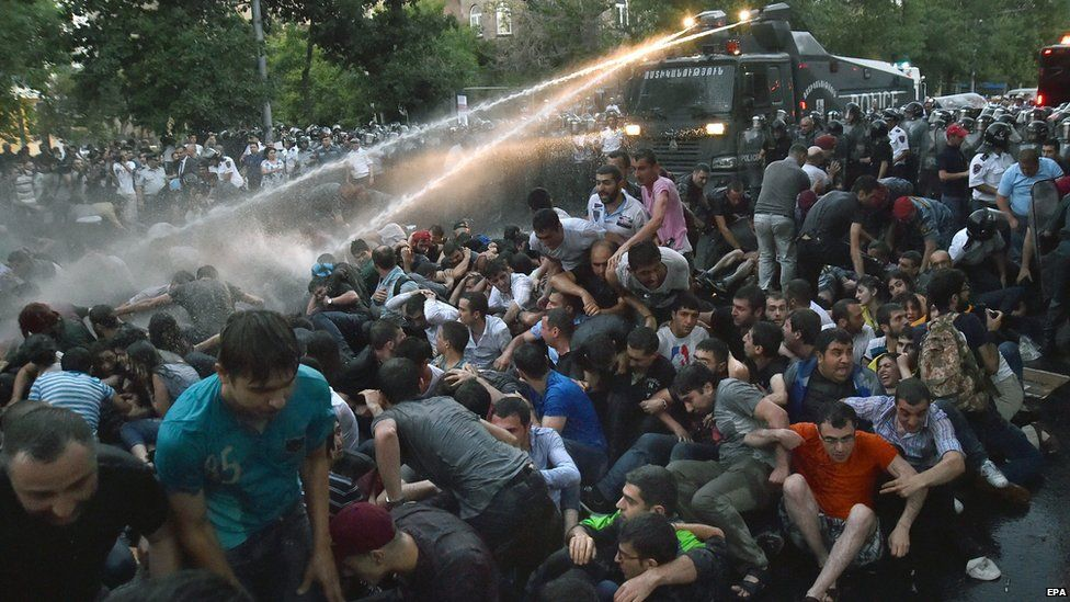 Armenian police forces use water cannons against protesters on 22 June 2015