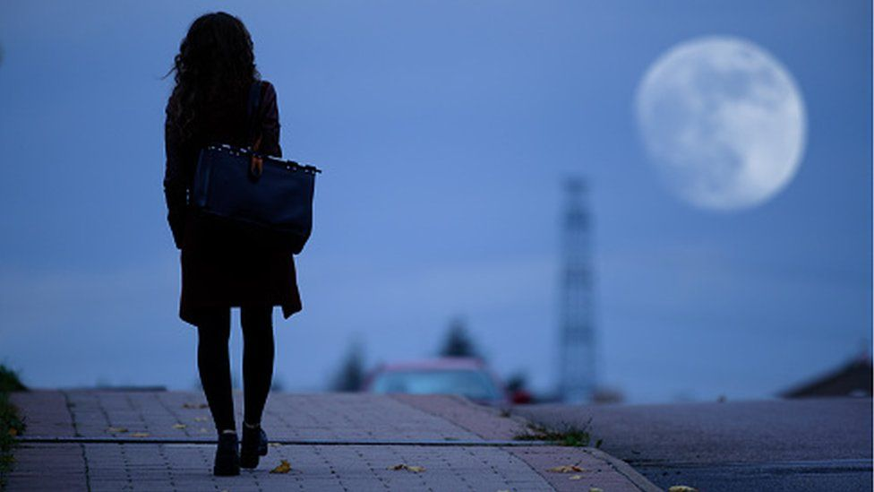 Young woman walking home alone
