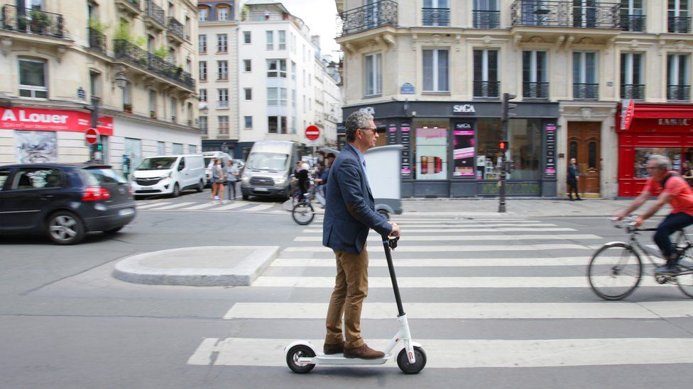 A man rides an electric scooter in Paris on 17 June 2019