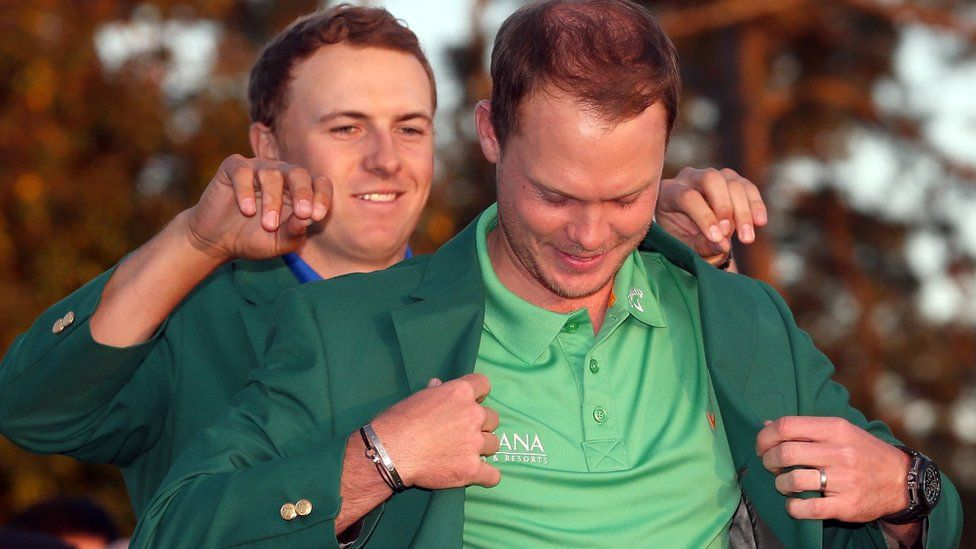 Danny Willett dons a green jacket after winning the wins the 2016 Masters