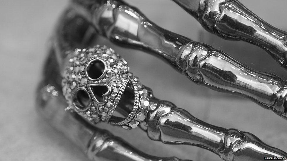 Metallic skull and hand