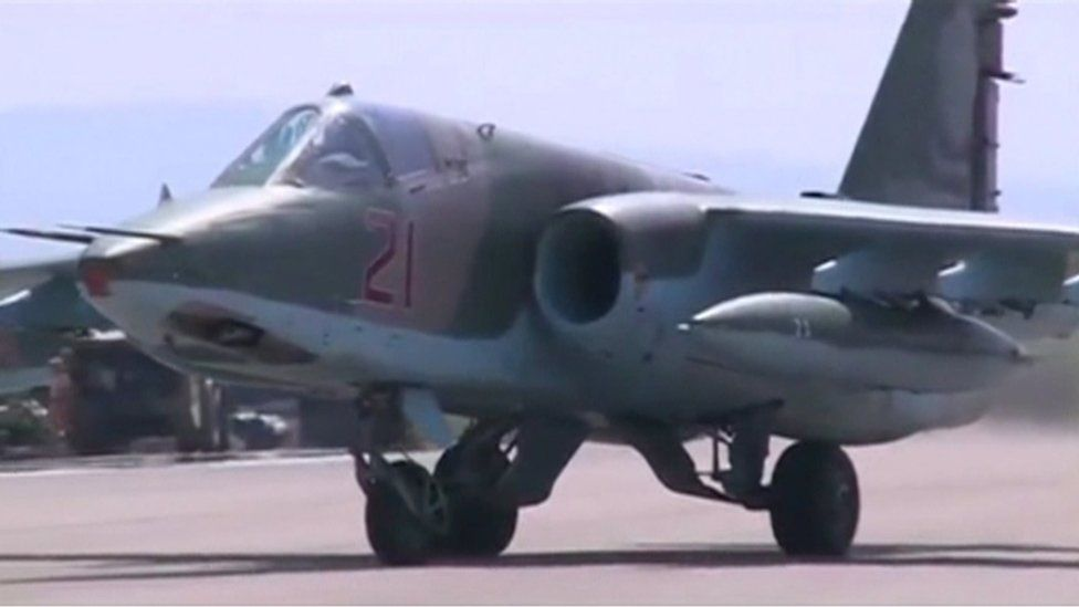 """A frame grab taken from footage released by Russia""""s Defence Ministry October 5, 2015, shows a Russian air force jet taxiing on the tarmac of Heymim air base in Syria."""