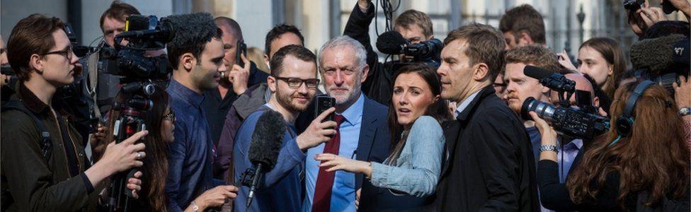 Jeremy Corbyn amid journalists