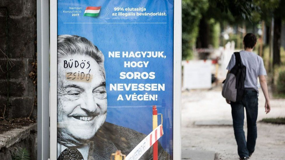 """A poster showing George Soros, on which someone has written """"dirty Jew"""""""