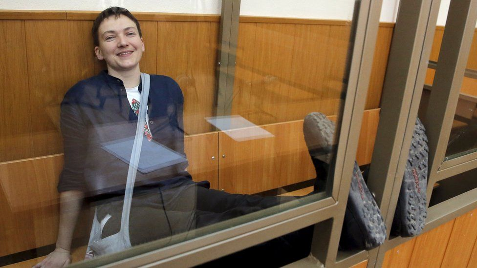 Former Ukrainian army pilot Nadiya Savchenko smiles from a glass-walled cage during a verdict hearing at a court in the southern border town of Donetsk in the Rostov region, Russia, 22 March 2016