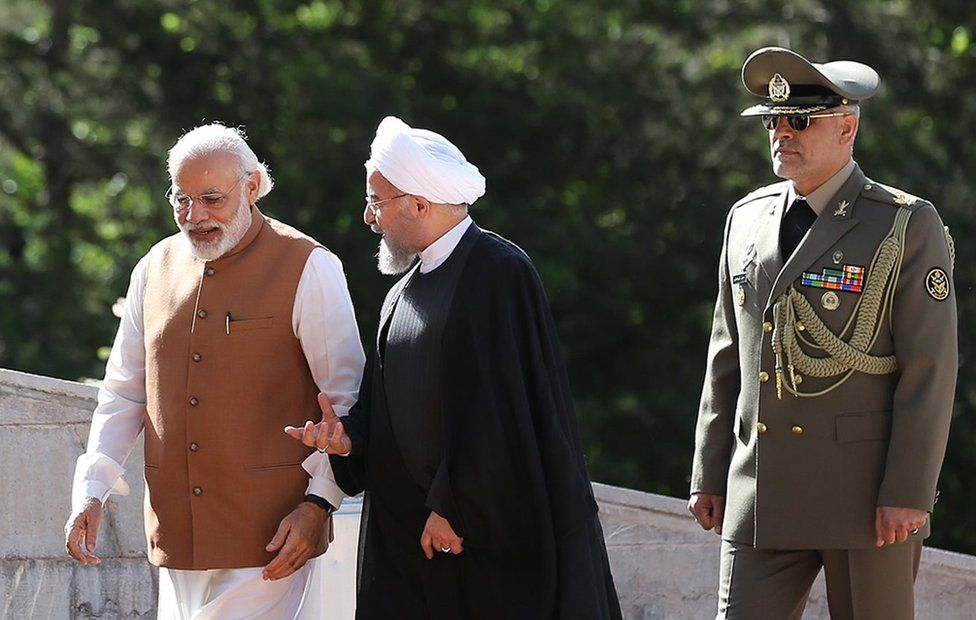 Indian Prime Minister Narendra Modi, left, walks with Iranian President Hassan Rouhani during a welcoming ceremony at the Saadabad Palace in Tehran, Iran, Monday, May 23, 2016.
