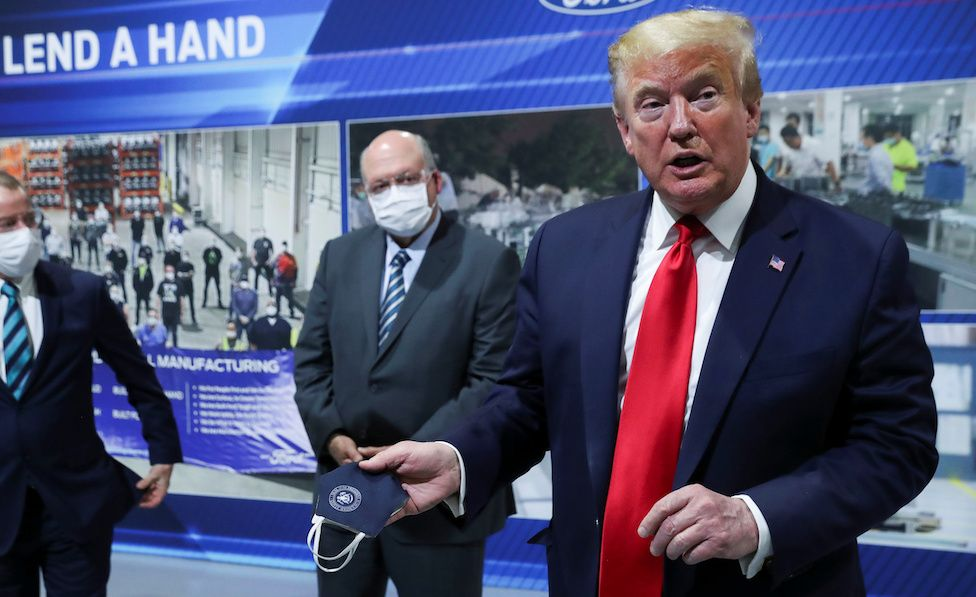 Donald Trump tours a Ford car factory that has switched to making ventilators