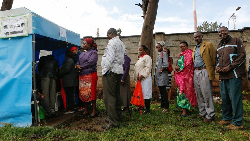 """Kenyan voters queue as they wait to cast their votes in Huruma, one of the ruling party Jubilee""""s strongholds in Nairobi, Kenya, 26 October 2017"""