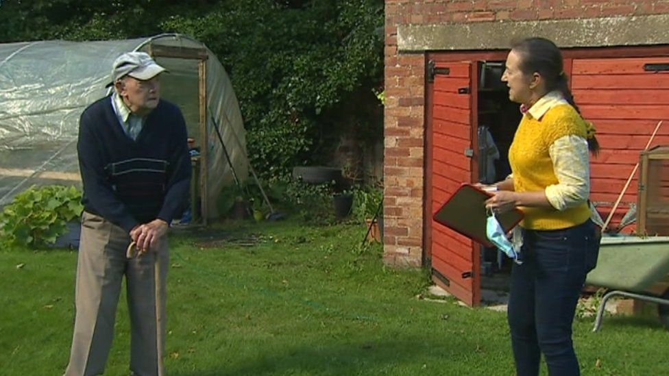 Bill Gosson and his daughter Sandra standing two metres apart in the garden
