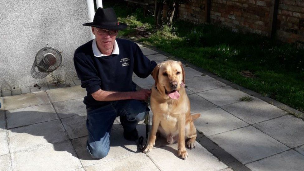 Roy Richards with guide dog Jones