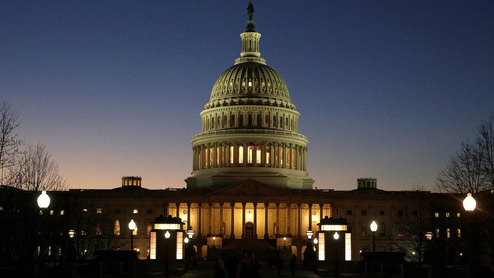 The U.S. Capitol Building is lit at sunset in Washington (December 20, 2016)