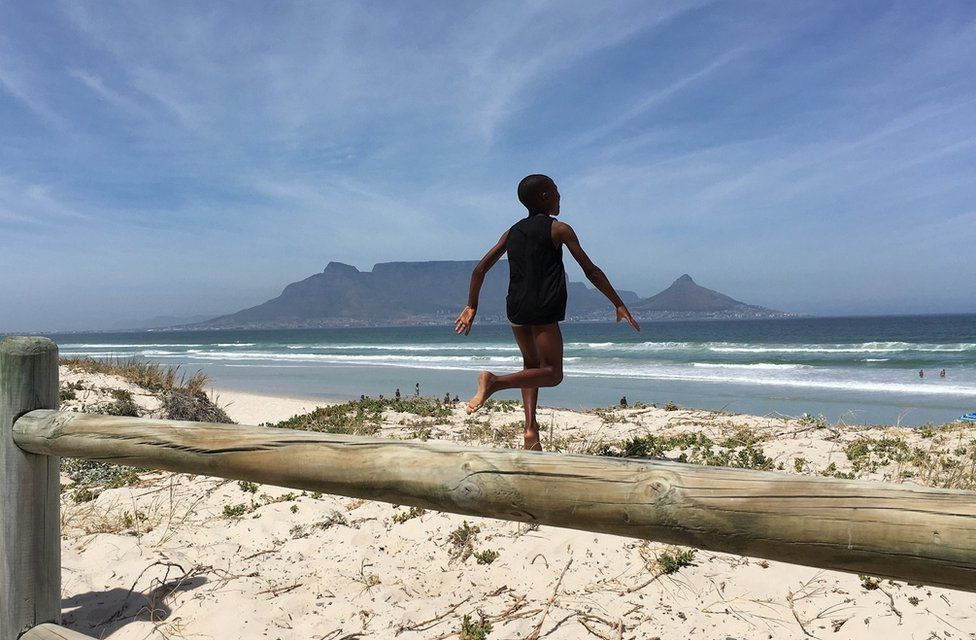 Boy running to the beach