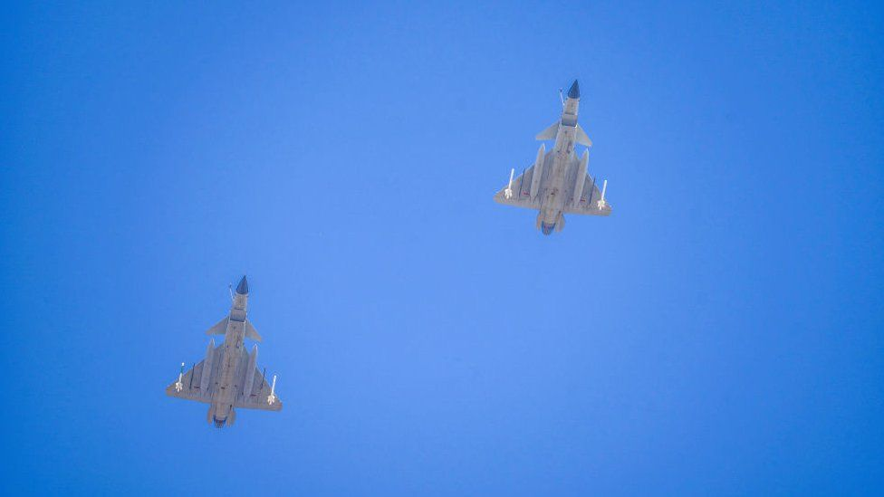 Two J-16 air fighters fly over a training base of PLA's naval aviation force in Ningbo in east China's Zhejiang province