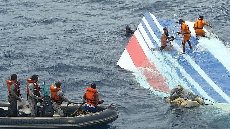 Handout image released on June 8, 2009 by the Brazilian Air Force (FAB) shows crew members preparing to tow a part of the wreckage of a Air Bus A330-200 jetliner