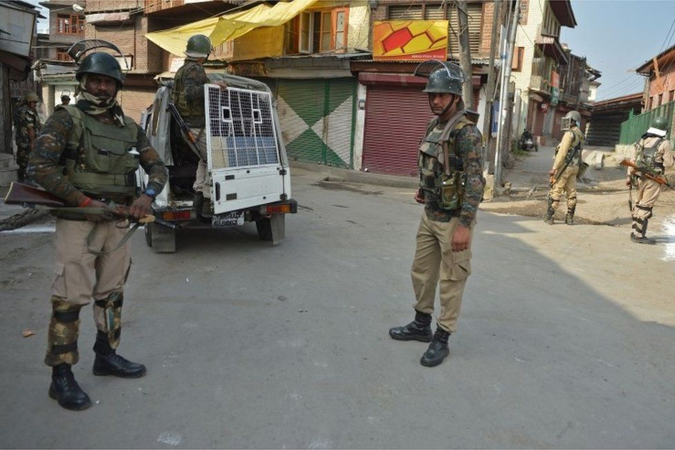 Indian government security forces stand guard near the mosque during the Muslim festival of Eid-ul-Adha during a curfew in Srinagar on September 13, 2016.