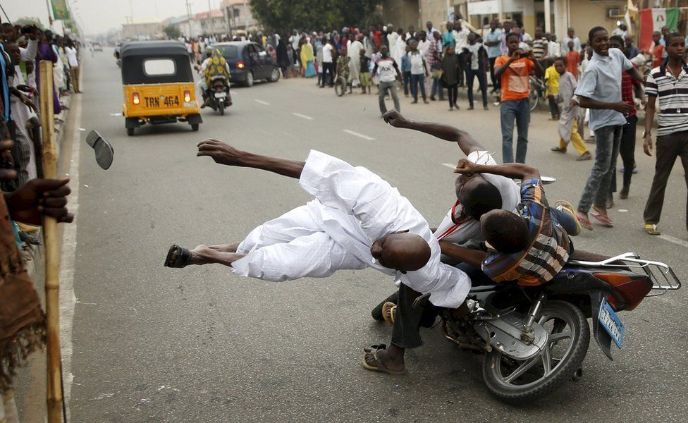Supporters of the presidential candidate Muhammadu Buhari and his All Progressive Congress hits another supporter with a motorbike during celebrations in Kano, Nigeria, 31 March 2015