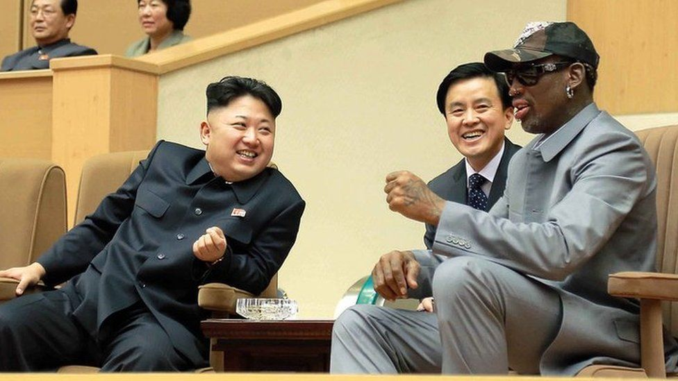 North Korean leader Kim Jong-un (C), his wife Ri Sol-Ju (L) and former US basketball star Dennis Rodman (R) watching a basketball game