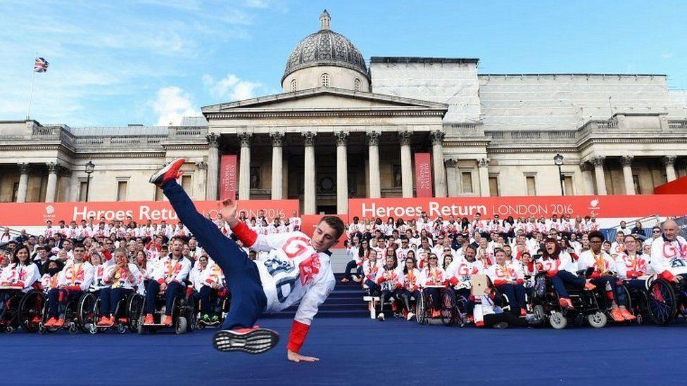 Max Whitlock performs acrobatics on stage at Trafalgar Square