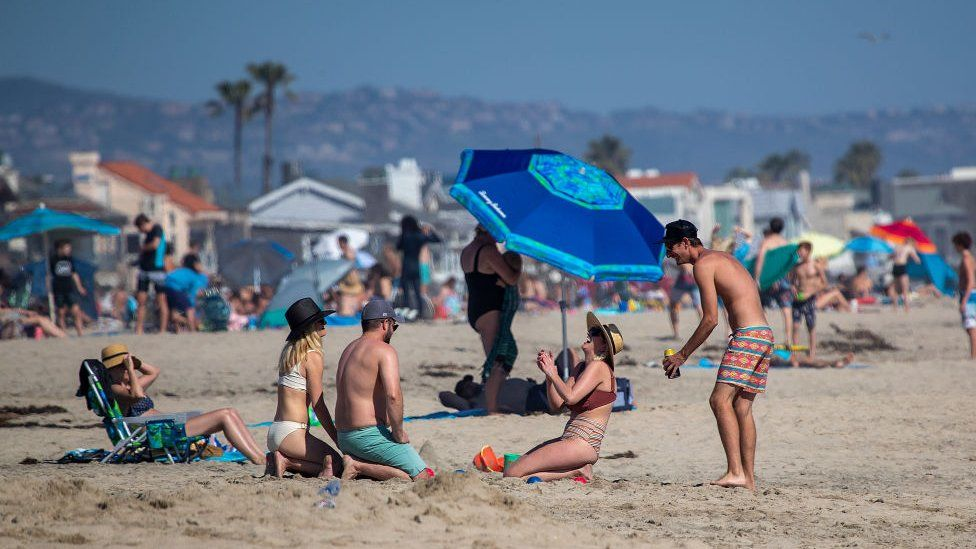 Beach-goers in California