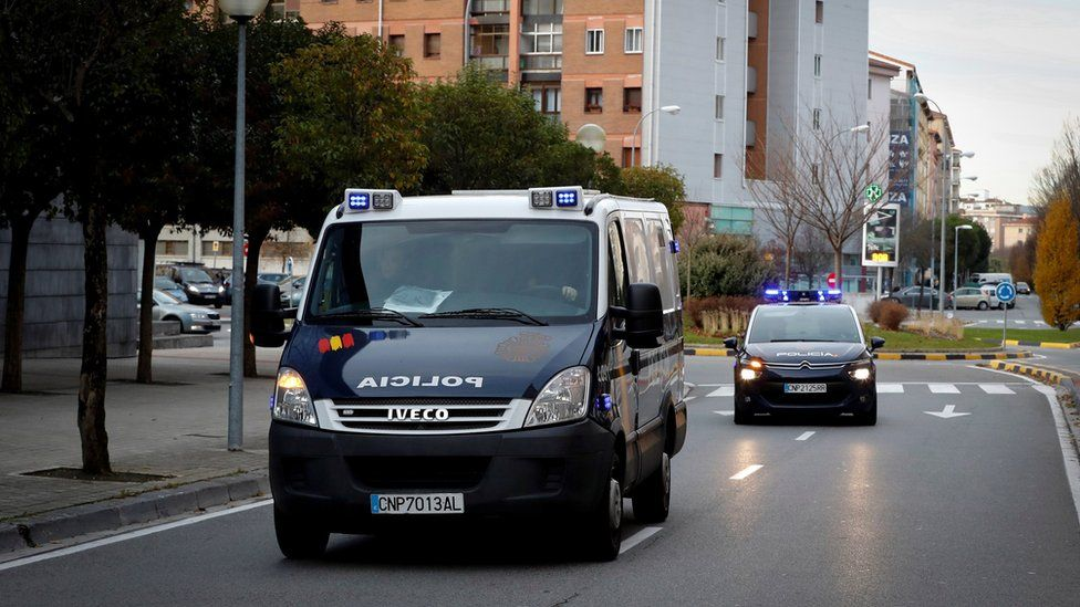 Police vehicles that carry the five men from Seville accused of an alleged gang rape