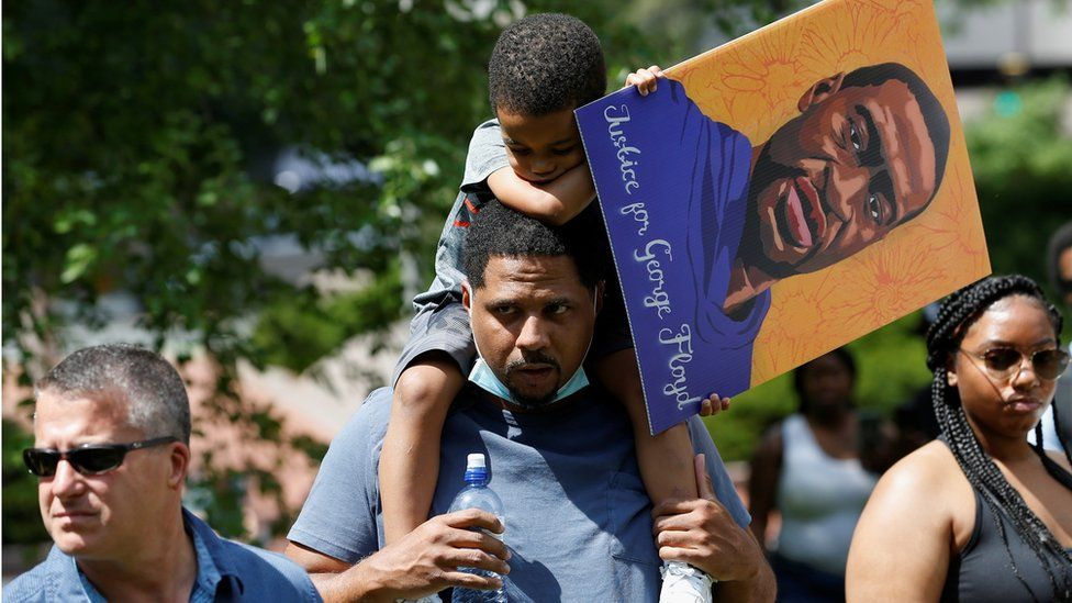 Supporters of George Floyd's family outside the courthouse in Minneapolis, MN (25 June)