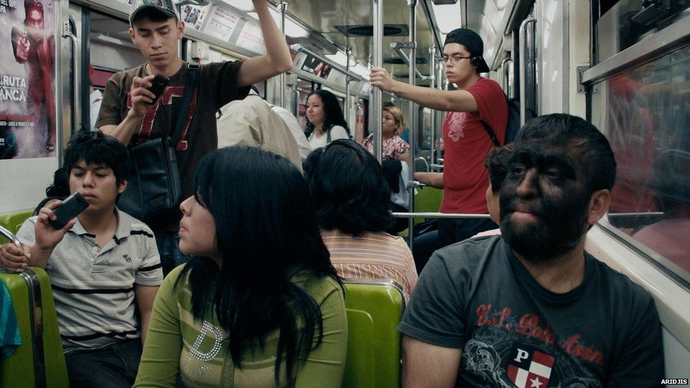 Aceves being photographed on the subway