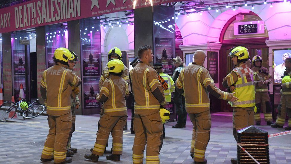 Firefighters outside the Piccadilly Theatre