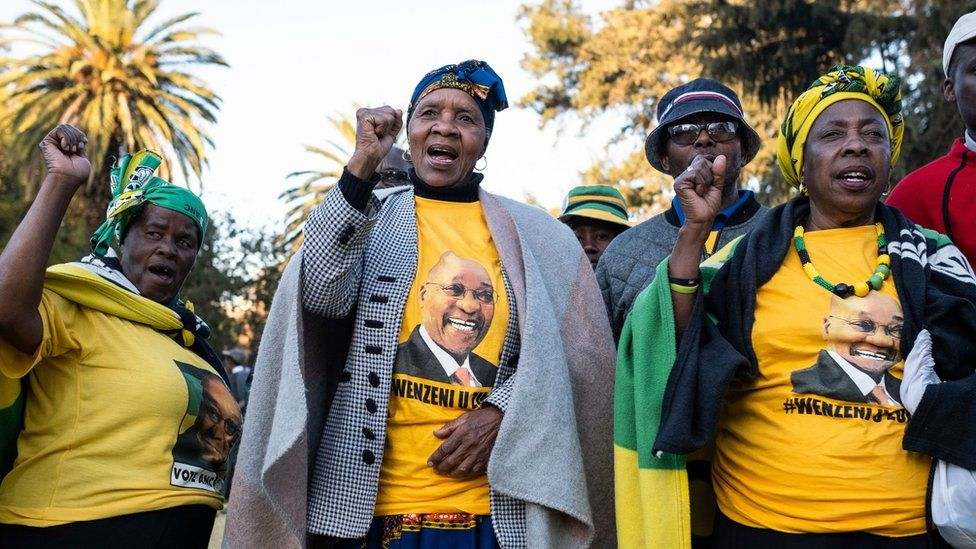 Zuma supporters chanting and wearing t-shirts bearing his face