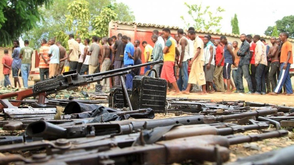 Suspected fighters are paraded before the media by Burundian police near a recovered cache of weapons after clashes in the capital Bujumbura, Burundi - 12 December 2015