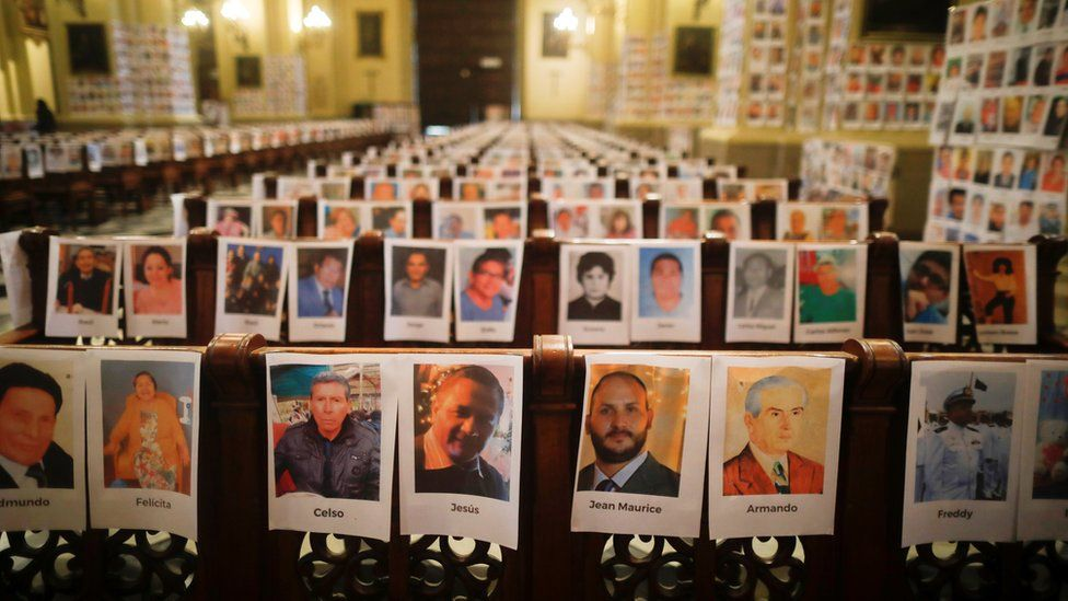 Photographs of Peru's victims of the coronavirus disease (COVID-19) are seen on the pews and walls of the Cathedral of Lima