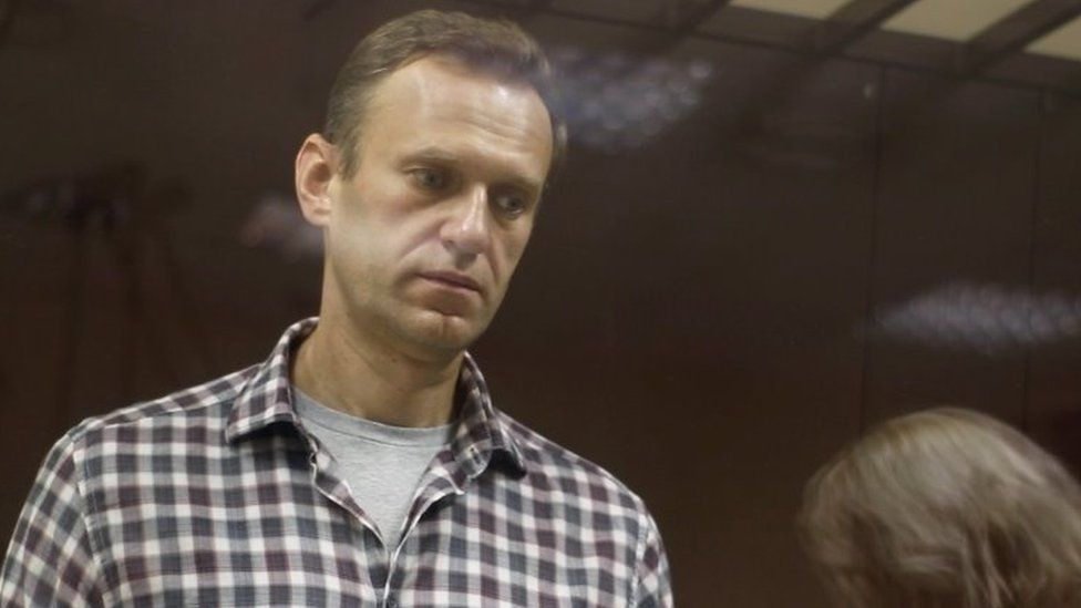 Kremlin critic Alexei Navalny stands inside a defendant dock during a court hearing in Moscow, Russia, on 20 February 2021,