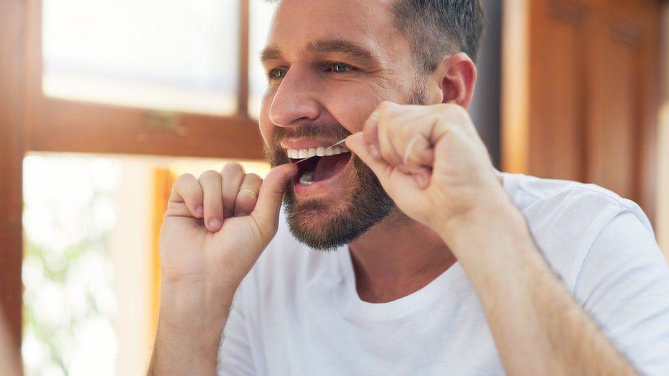 A man flossing