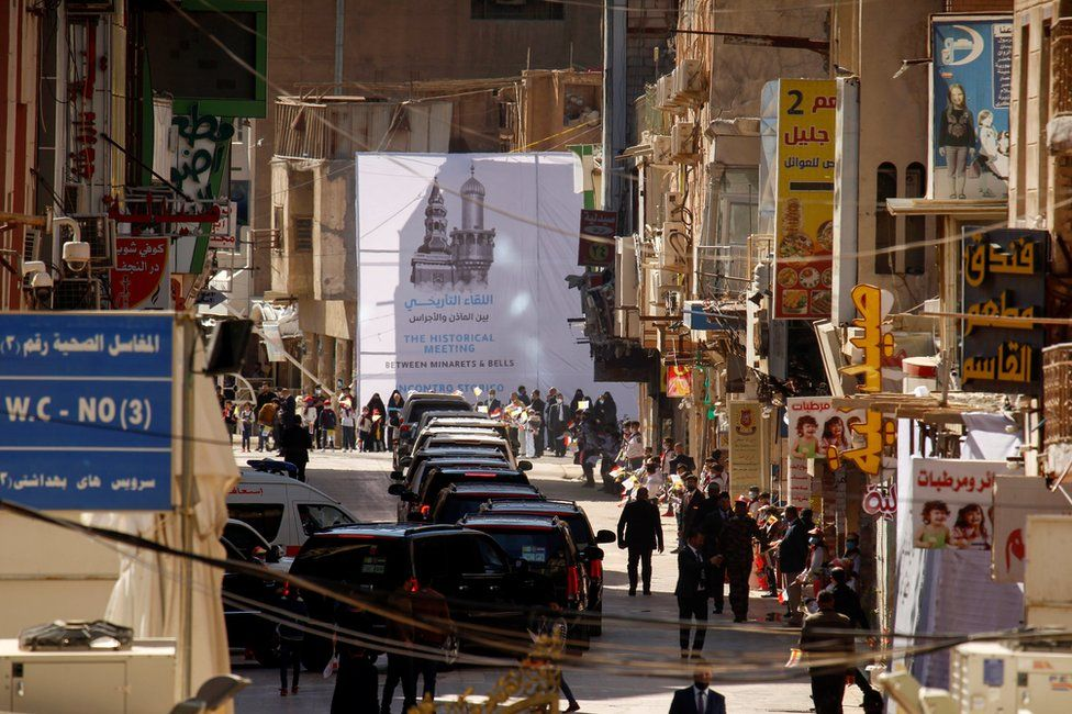 Pope Francis's convoy leaves after his meeting with Grand Ayatollah Ali al-Sistani in Najaf, Iraq March 6, 2021