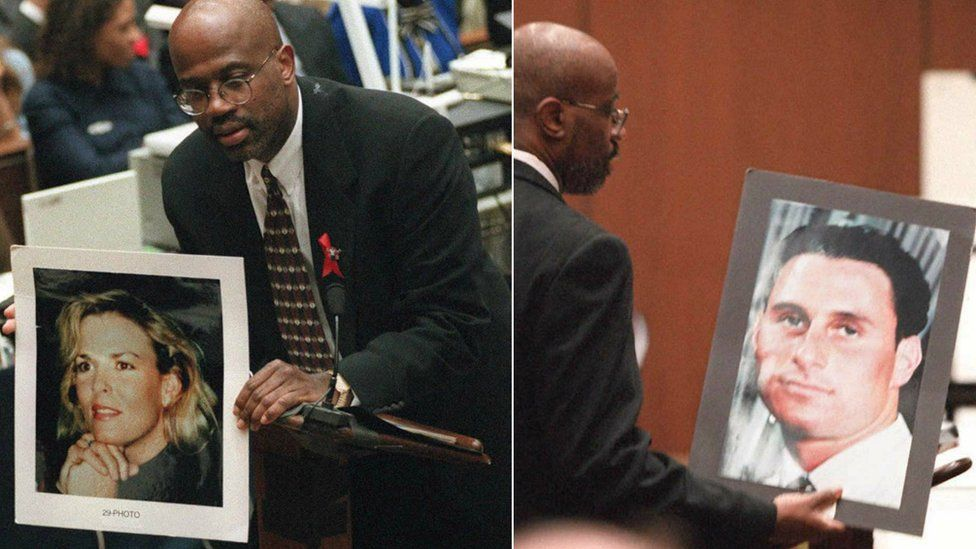 Prosecutor Christopher Darden holds up photographs of victims to jury at 1995 trial