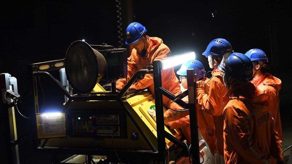 Rescuers adjust an emergency generator at the Diaoshuidong coal mine in south-western China's Chongqing on December 5, 2020