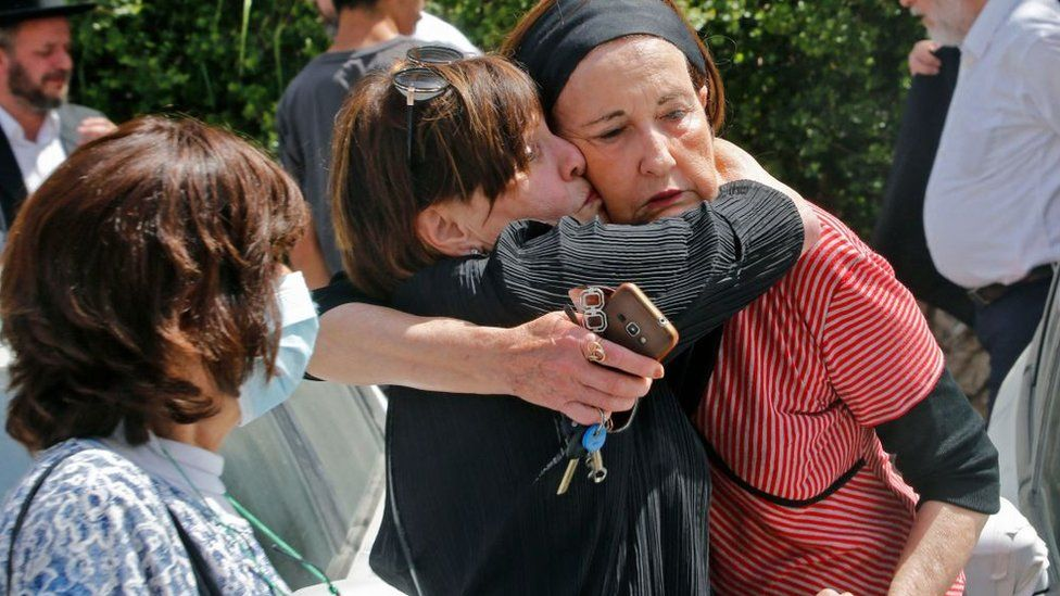 An Ultra-Orthodox Jewish woman comforts another at a cemetery in Bnei Brak, 30 April