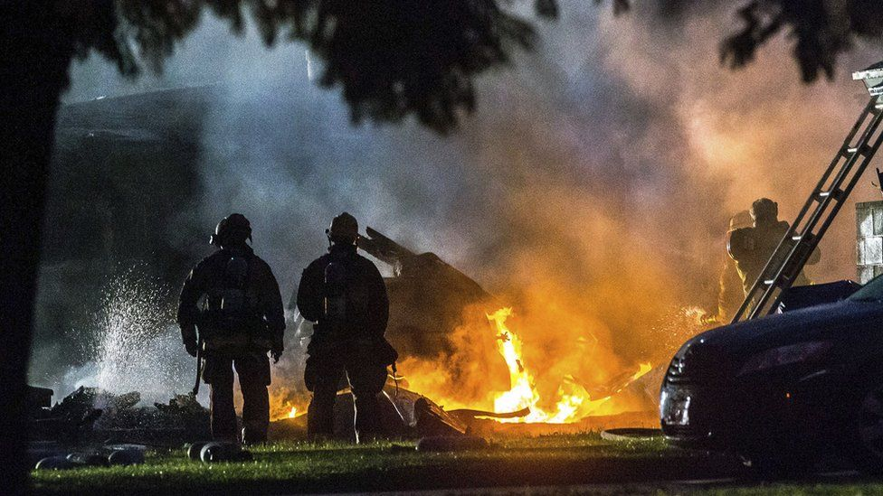 Firefighters tackle flames after a small plane crashed in Riverside, California, 27 February 2017