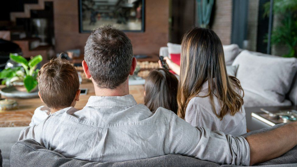 A family watching the TV
